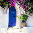 Picture - Door entrance with flowers in Parikia, Paros.