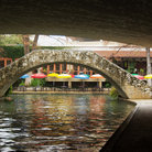 Picture - Bridges and umbrellas along the San Antonio River Walk.