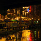 Picture - Lights on the San Antonio River Walk at night.