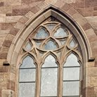 Picture - Arched window on Saint John's Church in Paterson, New Jersey.