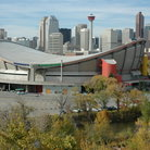 Picture - Calgary Saddledome in Stampede Park and skyline with Calgary Tower in the distance.