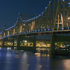 Picture - Night time view of a bridge in downtown Peoria.
