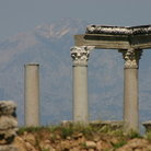 Picture - The Perge Ruins with mountains in behind.