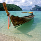 Picture - A longboat on the beach of Koh Phi Phi Don.
