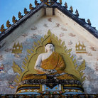 Picture - A buddha statue over the entrance to Wat Nakaram, Phuket.