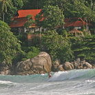 Picture - Surfing in front of a resort on Phuket.