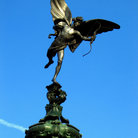Picture - Eros aims his bow high above Piccadilly Circus in London.