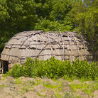 Picture - A Wampanoag Indian hut  located on the grounds of the Plimoth Plantation in Plymouth.