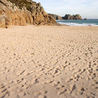 Picture - Footprints on the beach at Portcurno.