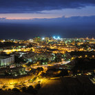 Picture - Night view over the coastal town of Puerto de la Cruz .
