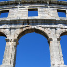 Picture - Arches of ancient roman amphitheater in Pula.