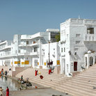 Picture - White buildings along the water at Pushkar.
