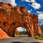 Picture - Highway running through an arch at Red Canyon.