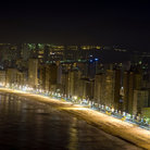Picture - The beach of Benidorm seen at night.