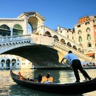 Picture - Gondola and the Rialto Bridge in Venice.