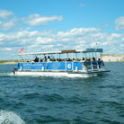 Picture - Essex River Cruise boat with beach background, Essex, MA.