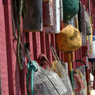 Picture - Buoys on historical building in Rockport.