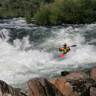 Picture - A kayaker in white water on the Rogue River.