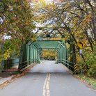 Picture - A steel bridge in Stewart Park in Roseburg, seen in the fall.