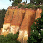 Picture - Red and ochre sandstone cliff in Roussillon.