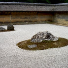 Picture - A zen rock garden in Ryoanji temple in Kyoto.