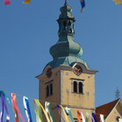 Picture - Flags and a church tower in Samobor.