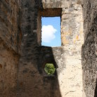 Picture - View through a window at the San Antonio Mission.
