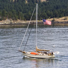 Picture - Sailboat off the shore of the San Juan Islands in Washington.