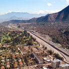 Picture - Aerial view over Santiago with the mountains in behind.