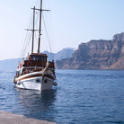 Picture - A schooner in the caldera at Santorini.