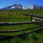 Picture - Rustic fence with Sawtooth Mountains as the backdrop.