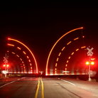 Picture - Railroad crossing at night in Scottsbluff, Nebraska.