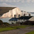 Picture - Cottage in front of the Seven Sisters chalk cliffs.