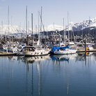 Picture - Boats docked at Seward with mountains in behind.