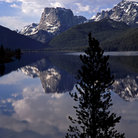 Picture - Squaretop Mountain reflecting in the calm Green River Lake in the Shoshone National Forest.