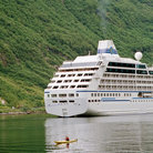 Picture - Cruise ship and kayak in Geirangerfjord.