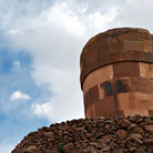 Picture - Looking up at a funerary tower at Sillustani.