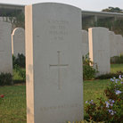 Picture - A tombstone for an unknown soldier at the Kranji War Memorial in Singapore.