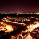 Picture - View over the streets of Singapore at night.