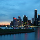 Picture - Boats and highrises of the Singapore skyline.