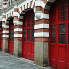 Picture - Red and white façade of an old fire station in Singapore.