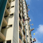 Picture - Laundry hanging out the windows of a skyscraper in Singapore.