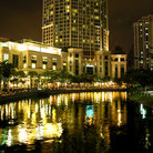 Picture - Buildings along the river at night in Singapore.
