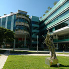 Picture - Statue and glass buildings at the University of Singapore.