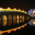 Picture - Chinese Garden and bridge lit up at night in Singapore.