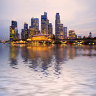 Picture - Singapore city seen from the water.