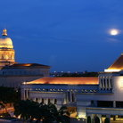 Picture - The Supreme Court and Parliament in Singapore at night.