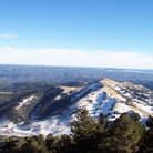 Picture - The white snow-capped mountains off Ski Apache in Ruidoso.