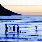 Picture - People on the beach at Gordon's Bay.