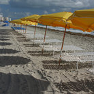 Picture - Yellow umbrellas along the beach of South Beach, Miami.